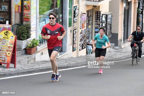 Canadian Prime Minister Justin Trudeau jogs in Taormina after a G7 Summit of Heads of State and of Government on May 27 2017 in Sicily / AFP PHOTO /...