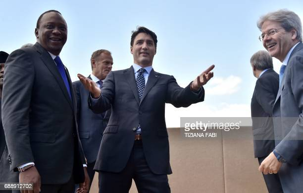 Canadian Prime Minister Justin Trudeau Kenya's President Uhuru Kenyatta and Italian Prime Minister Paolo Gentiloni arrive for a family photo with...