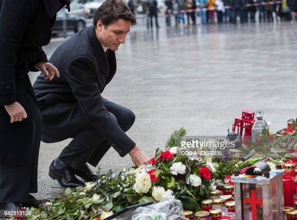 Canadian prime minister Justin Trudeau lays down a flower at a memorial to the victims of the Breitscheidplatz Christmas market attack near the...