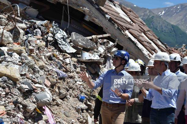 Canadian Prime Minister Justin Trudeau listens to Italy's Foreign Affairs Minister Angelino Alfano during a visit in earthquakedevastated village...