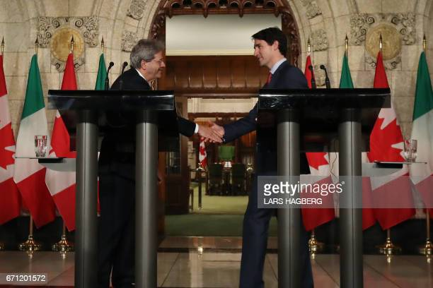 Canadian Prime Minister Justin Trudeau R and Prime Minister Paolo Gentiloni of Italy shake hands after they hold a joint press conference in the...