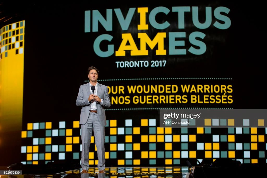 Canadian Prime Minister Justin Trudeau speaks during the opening ceremonies of the Invictus Games in Toronto, Ontario, September 23, 2017. / AFP PHOTO / Geoff Robins