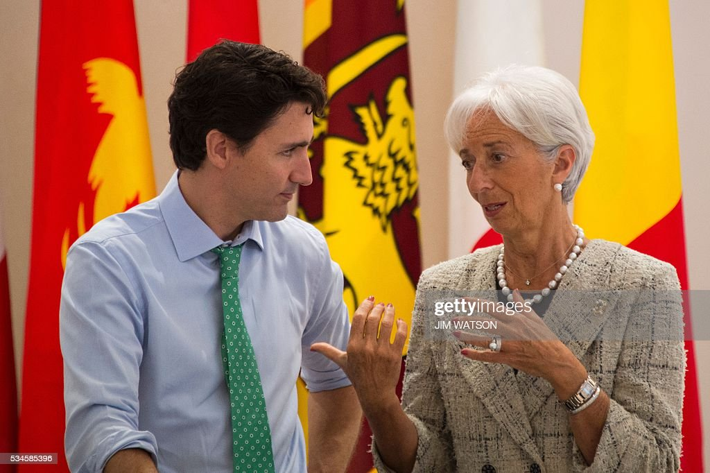 Canadian Prime Minister Justin Trudeau (L) speaks with International Monetary Fund (IMF) managing-director Christine Lagarde (R) as they take part in a dialogue with world leaders at the G7 Summit in Shima in Mie prefecture on May 27, 2016. A British secession from the European Union in next month's referendum could have disastrous economic consequences, G7 leaders warned on May 27 at the close of the summit in Japan. / AFP / POOL / JIM