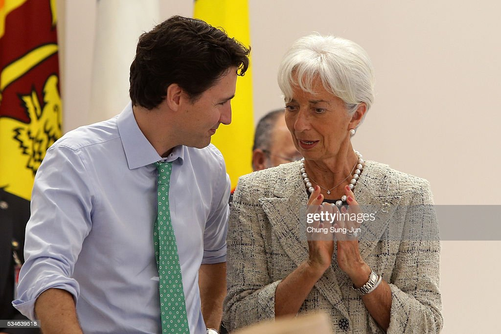 Canadian Prime Minister <a gi-track='captionPersonalityLinkClicked' href=/galleries/search?phrase=Justin+Trudeau&family=editorial&specificpeople=2616495 ng-click='$event.stopPropagation()'>Justin Trudeau</a> talks with International Monetary Fund Managing Director <a gi-track='captionPersonalityLinkClicked' href=/galleries/search?phrase=Christine+Lagarde&family=editorial&specificpeople=566337 ng-click='$event.stopPropagation()'>Christine Lagarde</a> during a 'Outreach Session' on May 27, 2016 in Kashikojima, Japan. In the two-day summit, the G7 leaders discussed the pressing global issues including counter-terrorism, energy policy, and sustainable development.