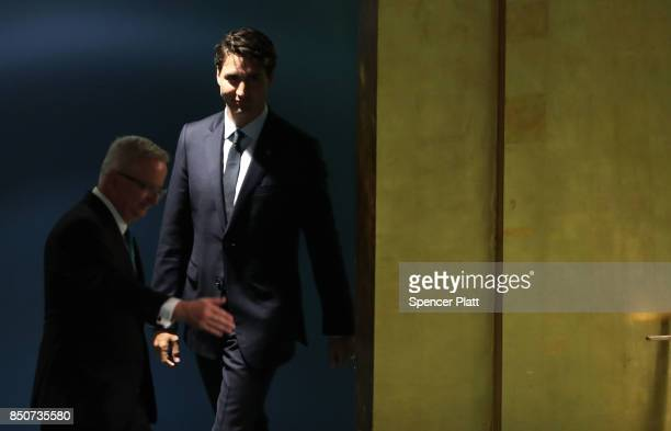 Canadian Prime Minister Justin Trudeau walks to the podium to address world leaders at the 72nd United Nations General Assembly at UN headquarters on...