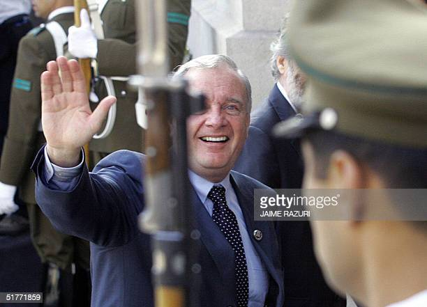 Canadian Prime Minister Paul Martin waves as he enters at La Moneda Presidential Palace to attend the opening of the APEC leaders' 2nd retreat AFP...