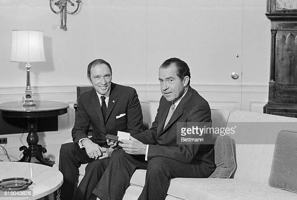 Canadian Prime Minister Pierre Trudeau and President Richard Nixon pose for picture on a sofa in the Chief Executive's office after the two leaders...