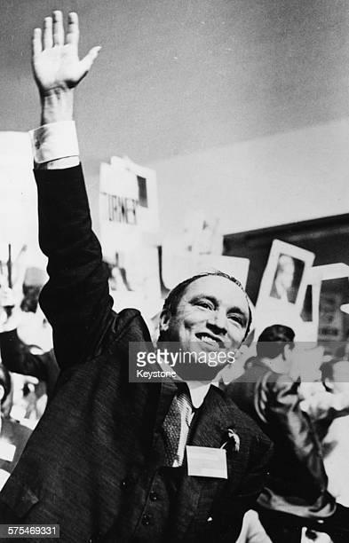 Canadian Prime Minister Pierre Trudeau raising his arm in celebration circa 1968