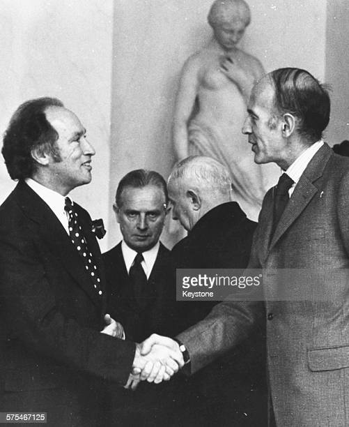 Canadian Prime Minister Pierre Trudeau shaking hands with French President Valery Giscard d'Estaing at the Elysee Palace Paris October 25th 1974