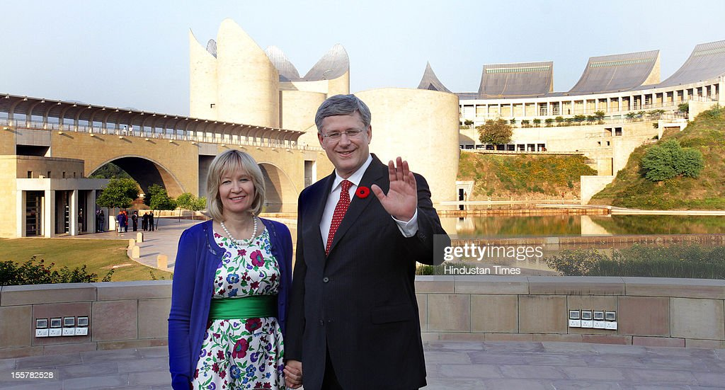 Canadian Prime Minister Stephen Harper and his wife Laureen Harper wave to the outside the Heritage Centre on November 7, 2012 in Anandpur Sahib, India.