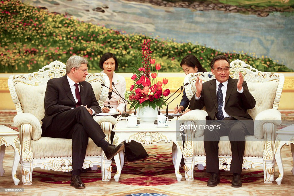 Canadian Prime Minister Stephen Harper listens to Wu Banguo Chairman of China's National People's Congress during their meeting at the Great Hall of...