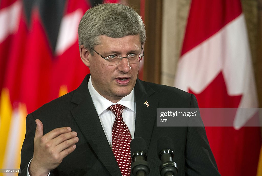 Canadian Prime Minister Stephen Harper speaks during a press conference with German Chancellor Angela Merkel after bilateral meetings in the Canadian Parliament in Ottawa, Ontario on August 16, 2012. Merkel is on an official visit to Canada from August 15-16.