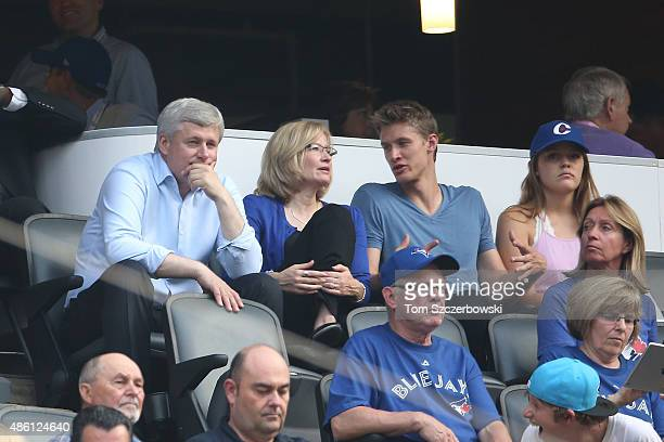 Canadian Prime Minister Stephen Harper watches the Toronto Blue Jays MLB game against the Cleveland Indians with his wife and son on August 31 2015...