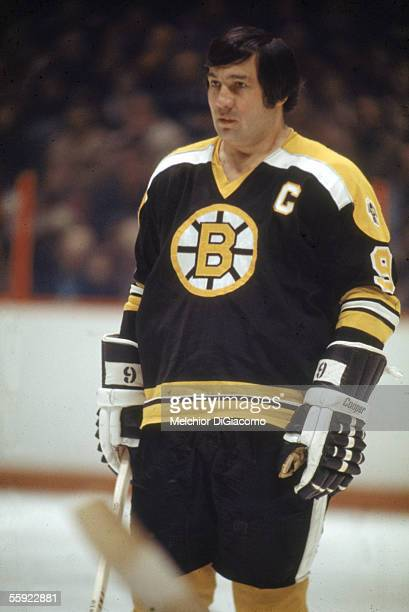 Canadian pro hockey player Johnny Bucyk captain of the Boston Bruins stands on the ice during an away game 1970s