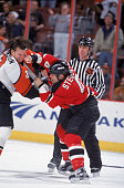 Canadian pro hockey player Scott Stevens of the New Jersey Devils punches Philadelphia Flyer defenseman Luke Richardson in the face during a fight at...