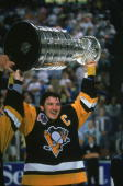 Canadian profession hockey player Mario Lemieux of the Pittsburgh Penguins hoists the Stanley Cup over his head as he celebrates the Pens' first...
