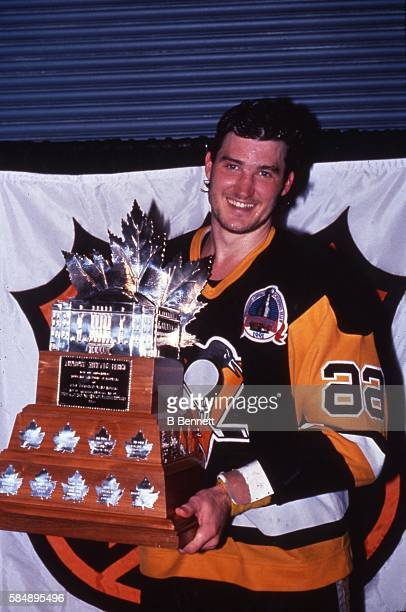 Canadian profession hockey player Mario Lemieux of the Pittsburgh Penguins pose with the Conn Smythe Trophy after his victory to win over the...