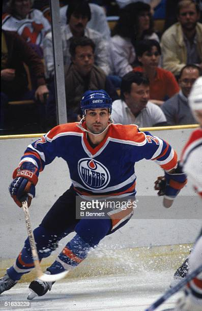 Canadian professional hockey player and 2004 Hall of Fame inductee defenseman Paul Coffey of the Edmonton Oilers skates on the ice against the New...