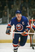 Canadian professional hockey player Denis Potvin defenseman for the New York Islanders skates near the goal during a game 1980s