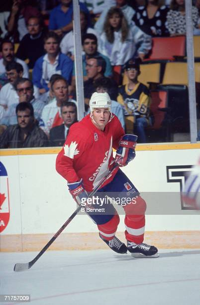 Canadian professional hockey player Eric Lindros center for the Oshawa Generals skates on the ice as a member of Team Canada during a game of the...