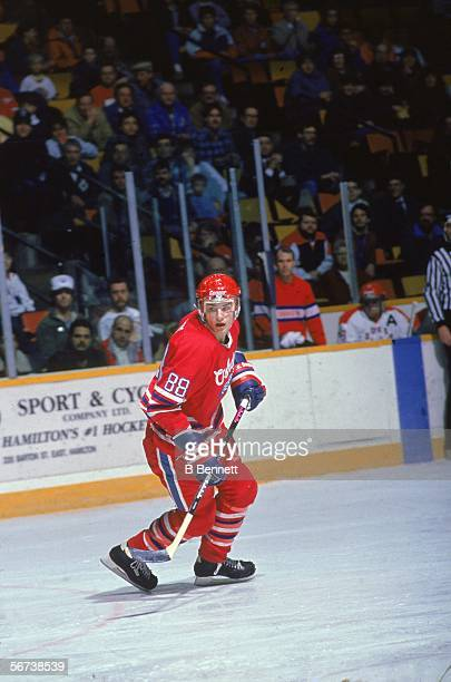 Canadian professional hockey player Eric Lindros skates on the ice in a road game against the Hamilton Dukes during his minor league days with the...