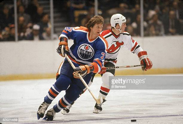Canadian professional hockey player Garry Unger forward for the Edmonton Oilers controls the puck during a road game against the New Jersey Devils...