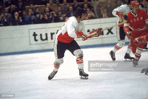 Canadian professional hockey player J P Parise of Team Canada checks Soviet players during a game at the 1972 Summit Series September 1972