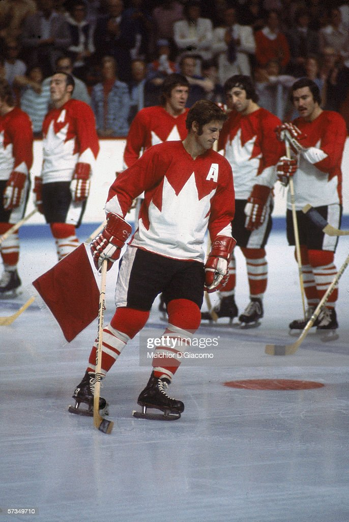 Canadian professional hockey player Jean Ratelle alternate captain of Team Canada skates in front of the team lineup during a game at the 1972 Summit...
