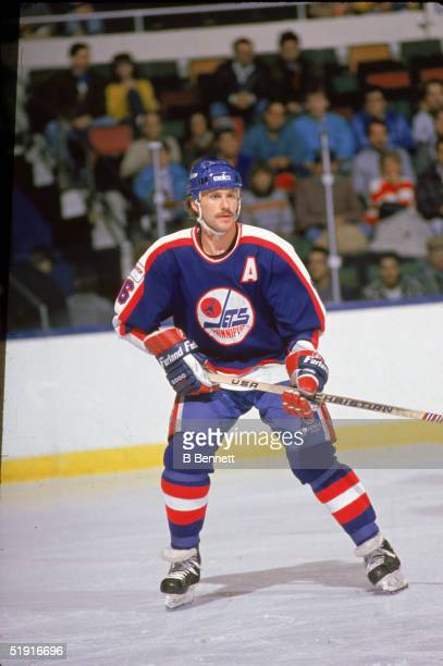 Canadian professional hockey player Laurie Boschman forward of the Winnipeg Jets skates on the ice during a road game against the New York Islanders...