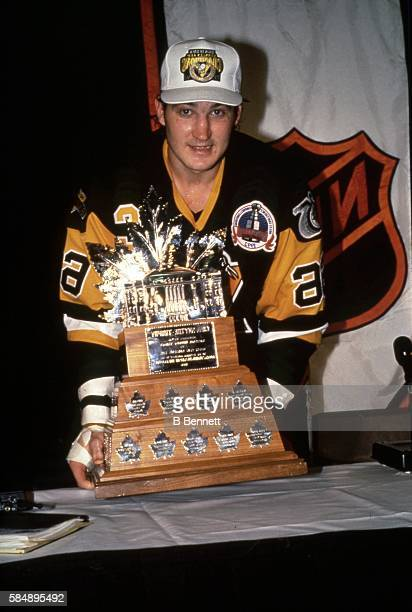 Canadian professional hockey player Mario Lemieux forward for the Pittsburgh Penguins pose with the Conn Smythe Trophy as the Pens celebrate their...