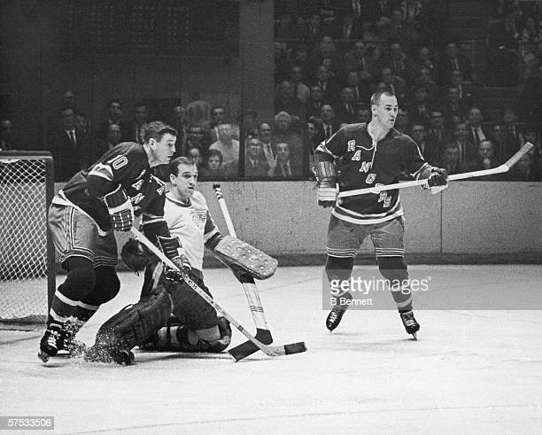 Canadian professional hockey player Roger Crozier goalie for the Detroit Red Wings attempts to defend the goal during a game with the New York...