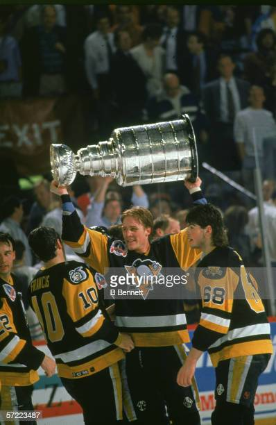Canadian professional hockey player Troy Loney forward for the Pittsburgh Penguins hoists the Stanley Cup over his head as he celebrates his team's...