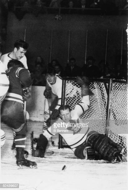 Canadian professional hockey player Turk Broda goalie of the Toronto Maple Leafs struggles to defend the goal during a game December 22 1946