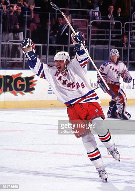 Canadian professional hockey player Wayne Gretzky forward of the New York Rangers celebrates a gametying goal December 4 1998