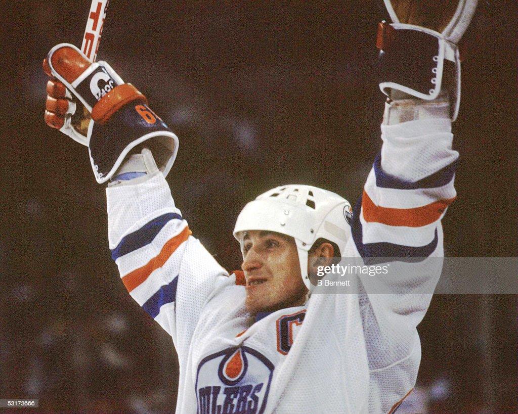 Canadian professional hockey player Wayne Gretzky, forward of the Edmonton Oilers, celebrates on the ice, 1980s.