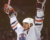 Canadian professional hockey player Wayne Gretzky forward of the Edmonton Oilers celebrates on the ice 1980s