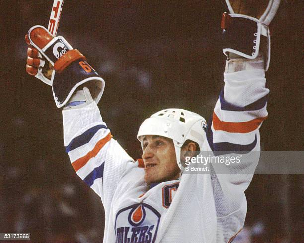 Canadian professional hockey player Wayne Gretzky forward of the Edmonton Oilers celebrates on the ice 1980s
