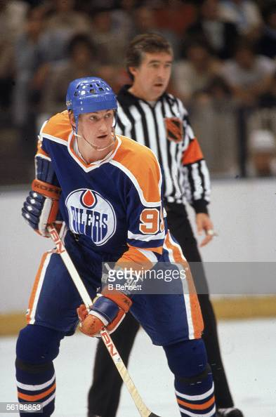 Canadian professional hockey player Wayne Gretzky of the Edmonton Oilers in action on the ice in front of an official for an away game during his...