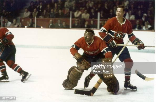 Canadian professional hockey players and Montreal Canadiens teammates goalie Tony Esposito and defenseman Ted Harris on the ice during a game at the...
