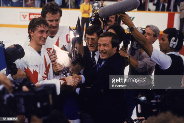 Canadian professional hockey players Wayne Gretzky and Larry Robinson are presented with the Canada Cup after Team Canada defeated Sweden in the...