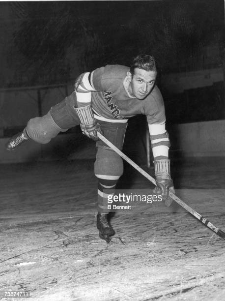 Canadian professional ice hockey player and coach Frank Boucher of the New York Rangers poses on the ice 1930s or 1940s Boucher returned to play...