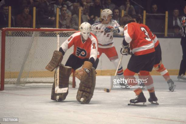 Canadian professional ice hockey player Bernie Parent goalie of the Philadelphia Flyers defends the goal during an away game against the New Yorjk...
