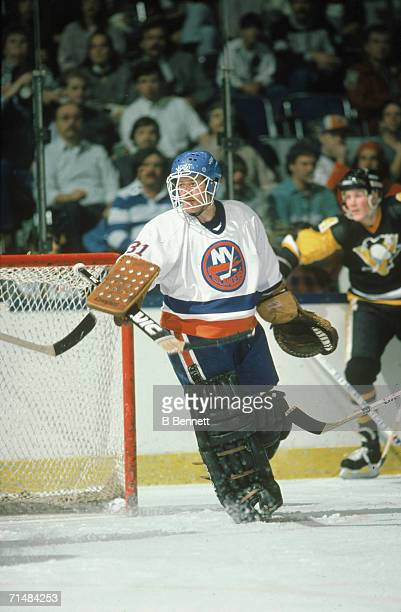 Canadian professional ice hockey player Billy Smith goalie of the New York Islanders on the ice during a home game against the Pittsburgh Penguins...