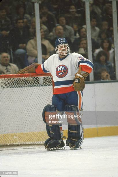 Canadian professional ice hockey player Billy Smith goalie of the New York Islanders leans on his goal during a home game Nassau Coliseum Uniondale...
