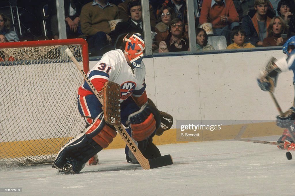 Canadian professional ice hockey player Billy Smith of the New York Islanders defends the goal during a home game Nassau Coliseum Uniondale New York...