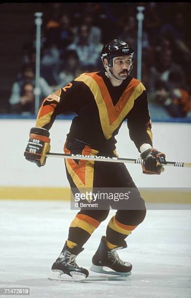 Canadian professional ice hockey player Dave 'Tiger' Williams of the Vancouver Canucks skates on the ice during a game against the New York Islanders...