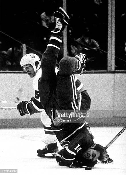 Canadian professional ice hockey player Denis Potvin of the New York Islanders upends fellow Canadian Guy Lafleur of the Montreal Canadiens during a...