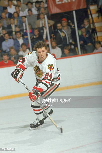 Canadian professional ice hockey player Doug Wilson of the Chicago Blackhawks skates with the puck on the ice during a home game Chicago 1980s Wilson...