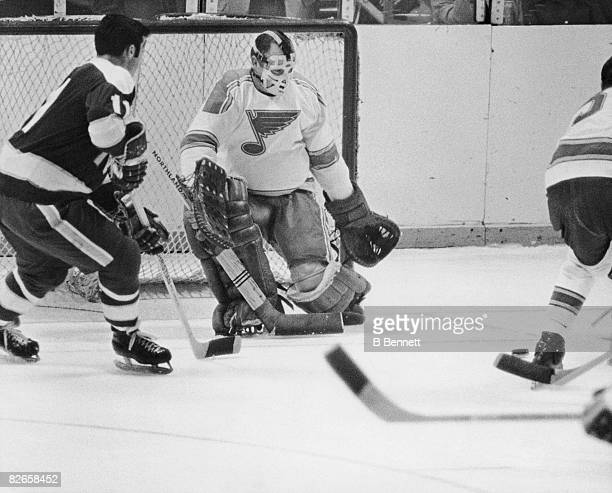Canadian professional ice hockey player Glenn Hall goalie for the St Louis Blues guards the goal during an away game late 1960s or early 1970s