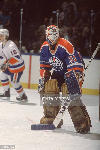 Canadian professional ice hockey player Grant Fuhr goalie of the Edmonton Oilers on guard on the ice during a game against the New York Islanders...